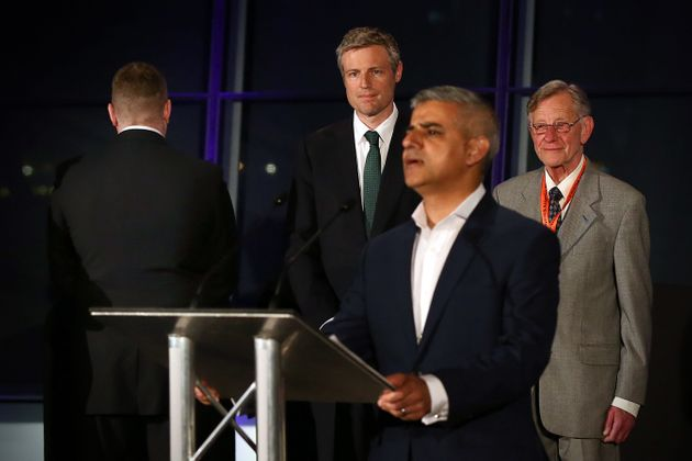 Britain First mayoral candidate, Paul Golding, turns his back as Sadiq Khan, Labour's newly elected London...