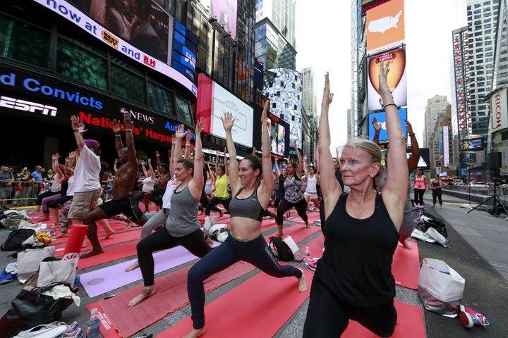 People do yoga in Times Square as part of the International Day of Yoga celebration on the summer solstice, June 21, 2015 in New York City.