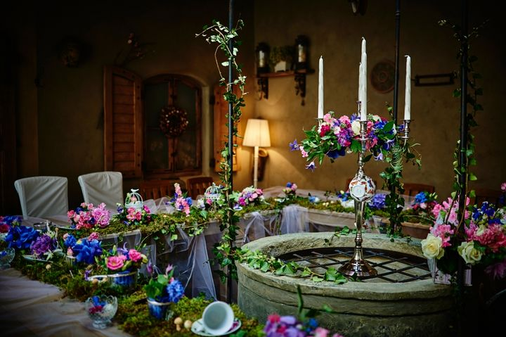 The tables featured moss and cascading garden party florals.