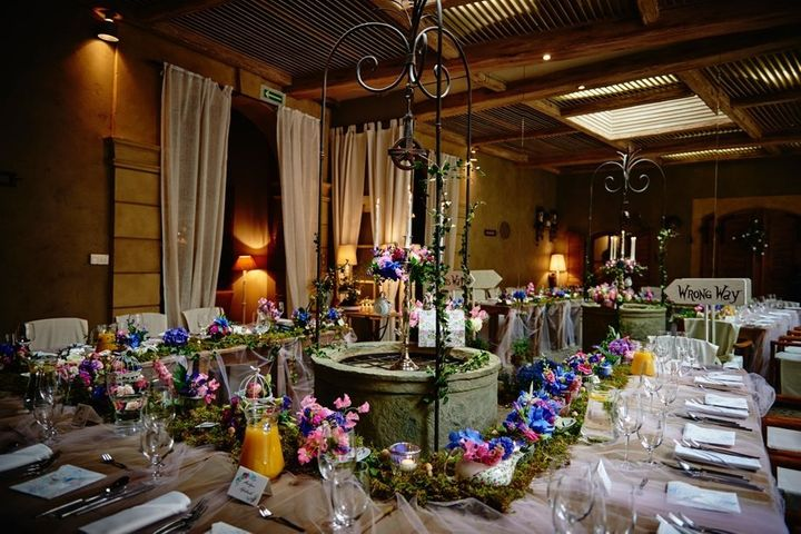 The large mirror beyond the table made it look as though guests were entering another world.