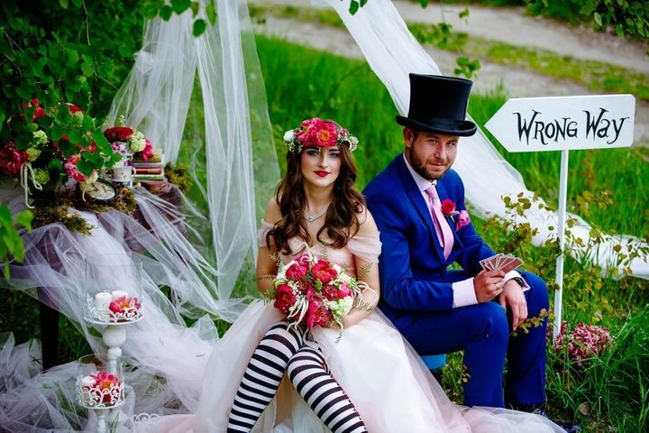 The Mad Hatter would definitely approve of the newlyweds' wacky attire.