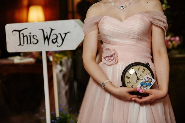 The couple incorporated fun details such as clocks, playing cards and arrow signs into the decor.