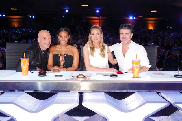 Mel B and Simon Cowell pose with fellow 'AGT' judges Howie Mandel and Heidi
