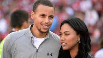 SAN FRANCISCO, CA - NOVEMBER 10:  Golden State Warroirs guard Stephen Curry and his wife Ayesha are fans on the sidelines during the Carolina Panthers and San Francisco 49ers NFL Game at Candlestick Park on November 10, 2013 in San Francisco, California. The Panthers won the game 10-9.  (Photo by Thearon W. Henderson/Getty Images)