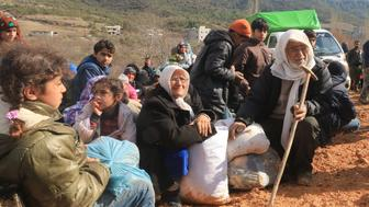 Internally displaced Syrians fleeing advancing pro-government Syrian forces wait near the Syrian-Turkish border after they were given permission by the Turkish authorities to enter Turkey, in Khirbet Al-Joz, Latakia countryside February 2, 2016. REUTERS/Ammar Abdullah