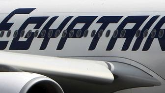 An EgyptAir plane is seen on the runway at Cairo Airport, Egypt in this September 5, 2013 file photo. REUTERS/Mohamed Abd El Ghany/Files