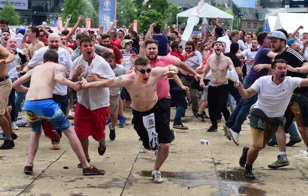 England fans in Lille celebrate as England score a late winning