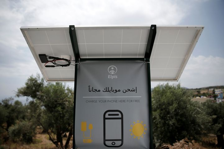 A solar powered charging station for mobile devices designed by a group of university students is seen at the municipality-ru