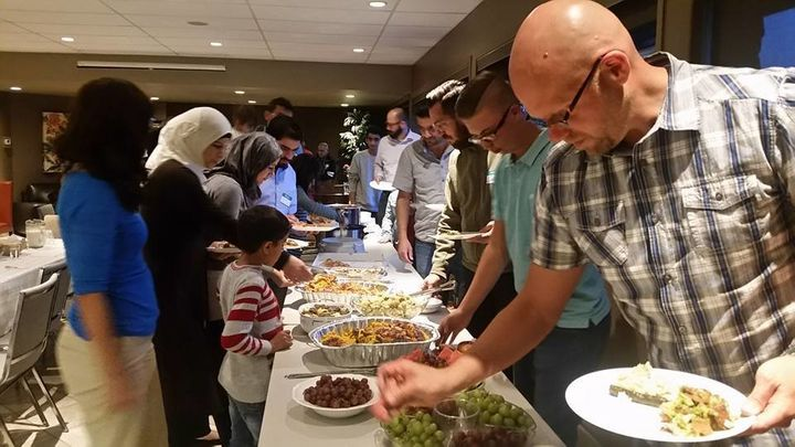 Muslims break their fast at a Ramadan iftar hosted by the Rockyview Alliance Church in Calgary, Alberta.