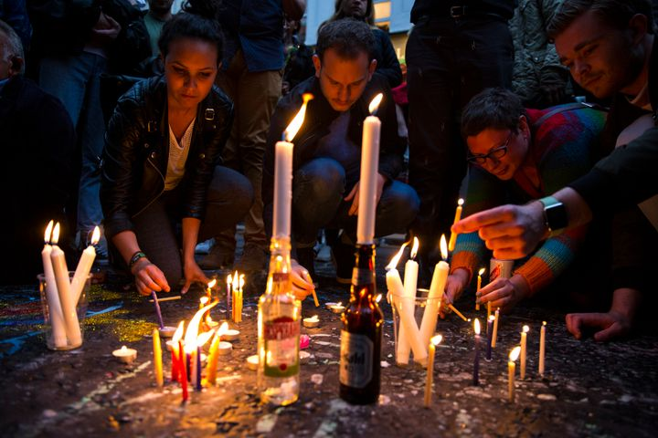 People light candles during a vigil for the victims of the Orlando nightclub shooting, on Old Compton Street, Soho on June 13