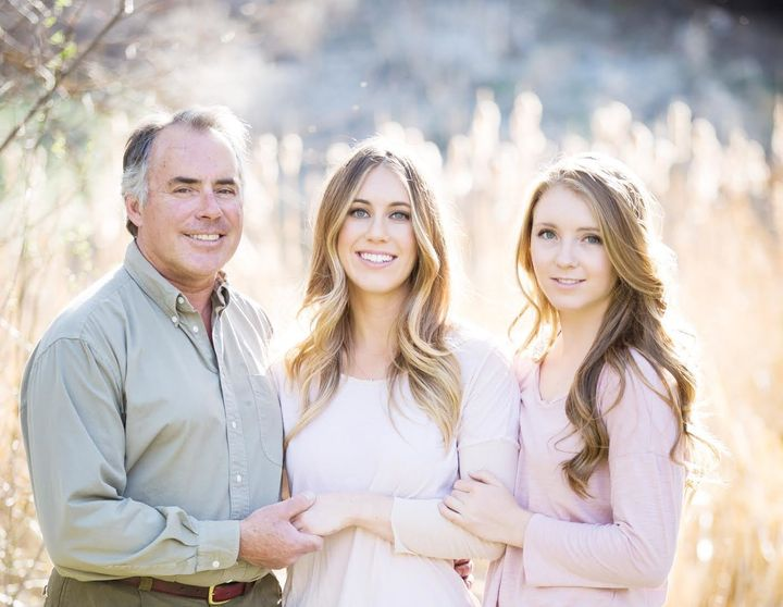 Chloe Mackintoshwith her dad and sister.