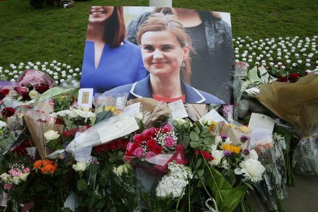 Floral tributes left in Parliament Square,