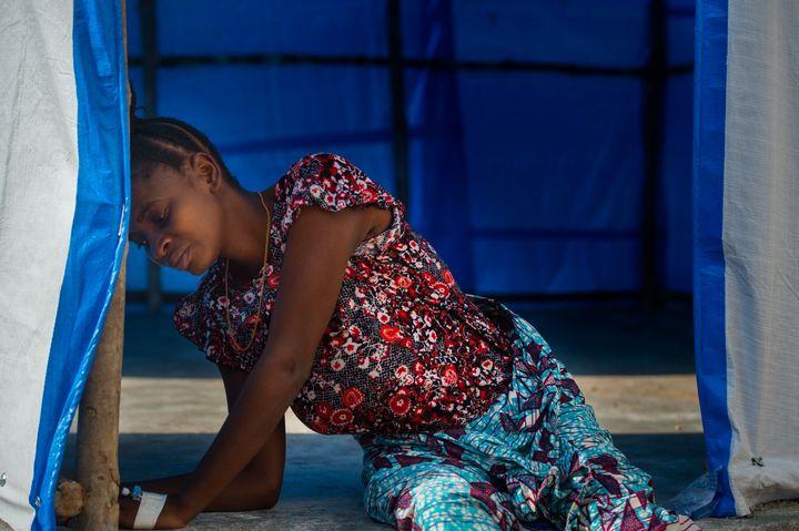 Mariatu Koroma, 18, four-months-pregnant, battles intense pain while waiting for an Ebola test in Port Loko, Sierra Leone, on