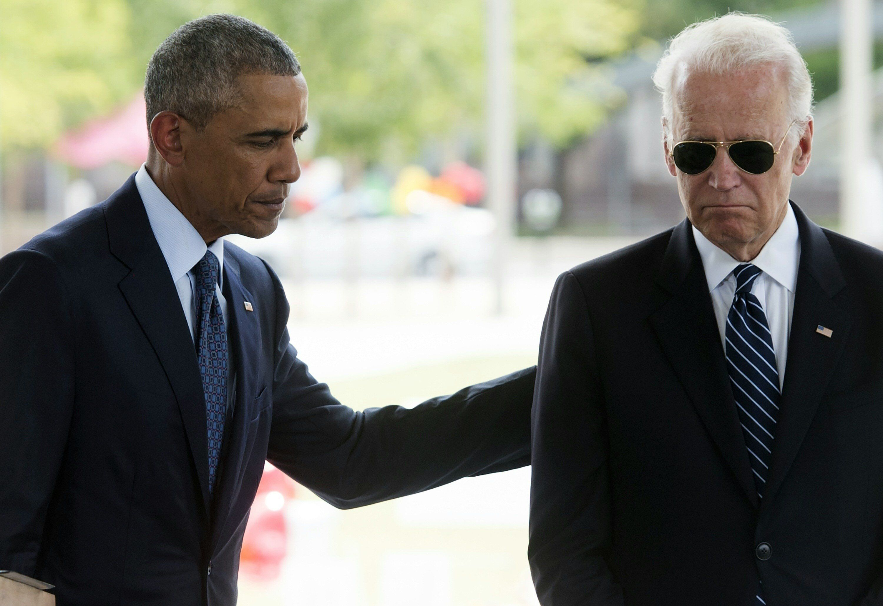 US President Barack Obama speaks alongside Vice President Joe Biden after placing flowers for the victims of the mass shooting at a gay nightclub Sunday at a memorial at the Dr. Phillips Center for the Performing Arts in Orlando, Florida, June 16, 2016. / AFP / SAUL LOEB        (Photo credit should read SAUL LOEB/AFP/Getty Images)