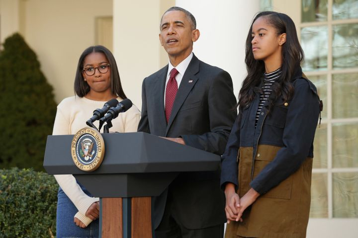 President Barack Obama, pictured here with his daughters, has pushed for policies like paid parental leave.