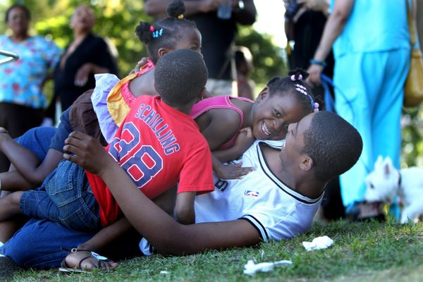 Siblings goofing around during Boston's 14th Annual Juneteenth Celebration in Franklin Park in 2010.