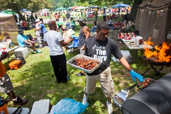 Jonathan Talley of Roxbury grills chicken, ribs, and sausage at Franklin Park for a 2014 Juneteenth celebration in Boston.&nb