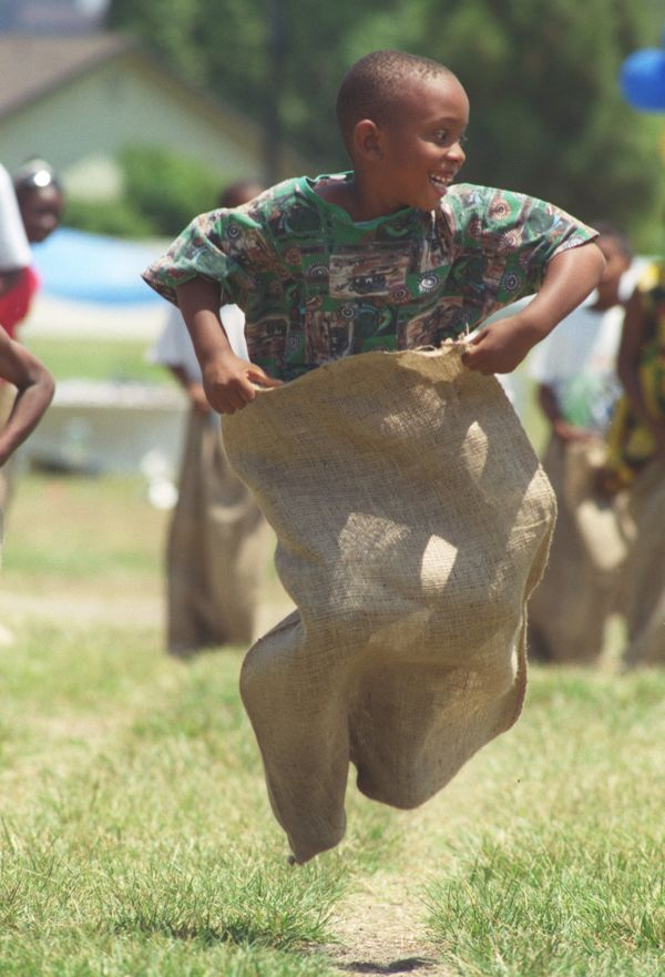A young boy participates in a sack race during the 1996 Juneteenth celebration in Santa Ana, California.
