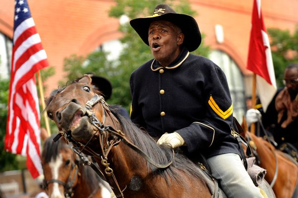 Jonas Felix leads the Buffalo Soldiers of the American West during a 2015 Juneteenth parade, in the historic Five Points neig