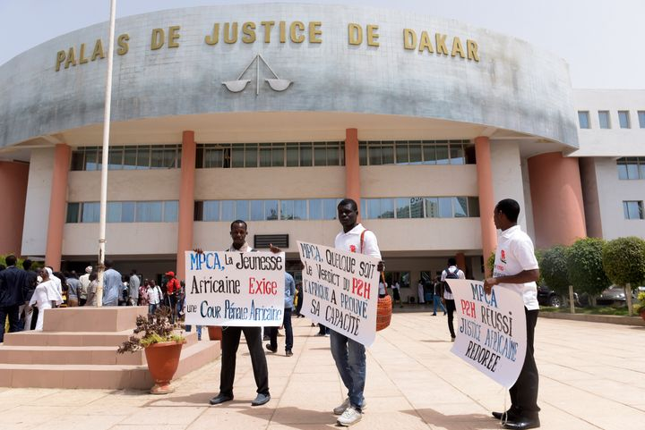 Demonstrators outside Dakar Courthouse ahead of the sentencing of former Chadian dictator Hissene Habre on May 30, 2016