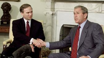 U.S. President George W. Bush poses with new U.S. Congressman Randy Forbes (R-VA) in the Oval Office of the White House in Washington, June 20, 2001. Forbes won the congressional seat last night after the state had a special election.  LSD