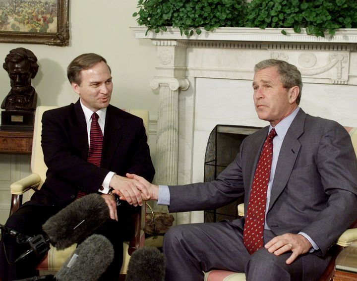 U.S. President George W. Bush poses with new U.S. Congressman Randy Forbes (R-VA) in the Oval Office of the White House in Wa