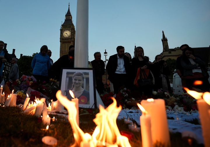 Mourners leave candles during a vigil at Parliament Square in London, in memory of murdered Labour Party member of parliament