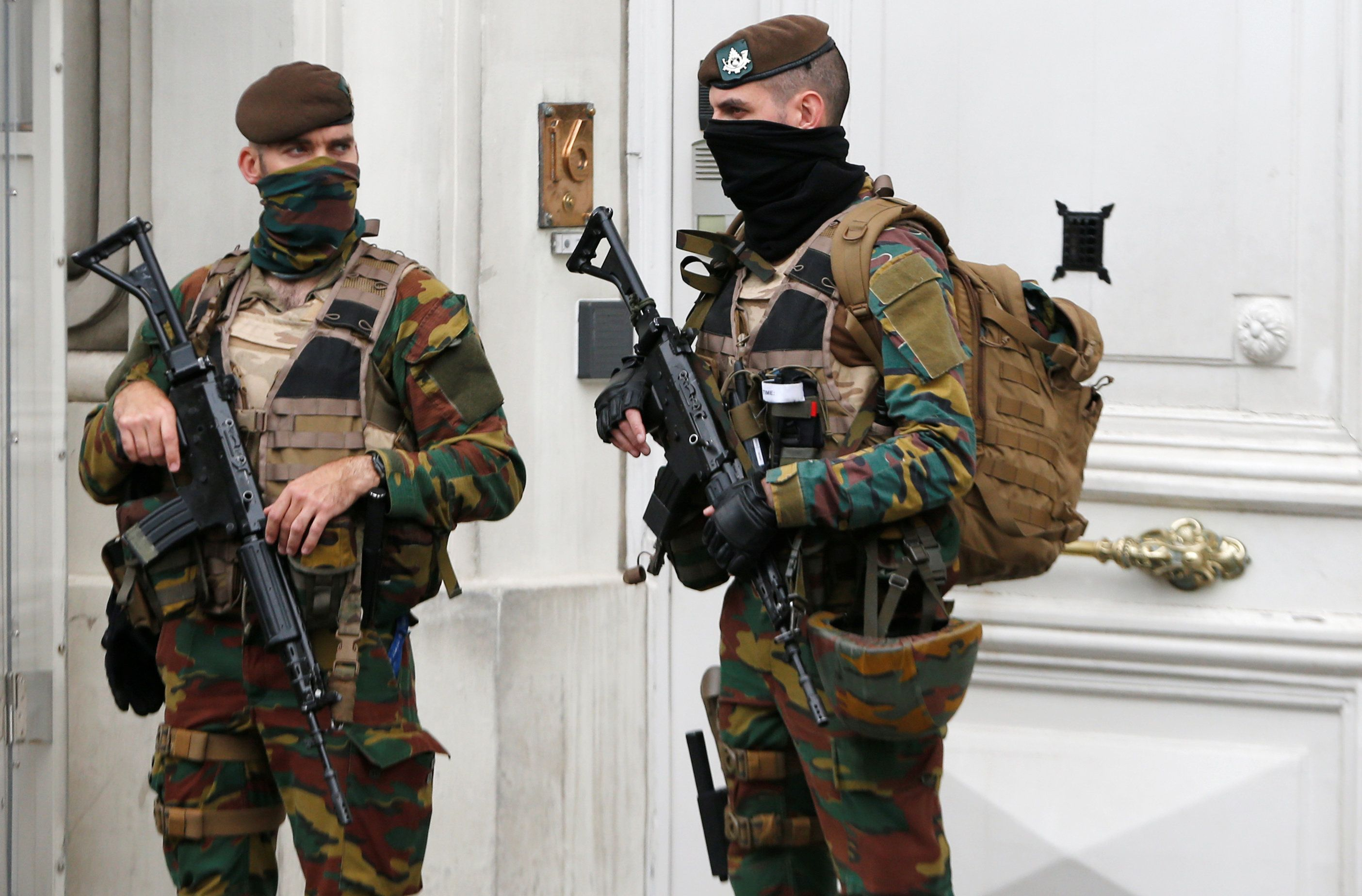 Belgian police arrested 12 suspects in a major anti-terror operation overnight. Above, Belgian soldiers...