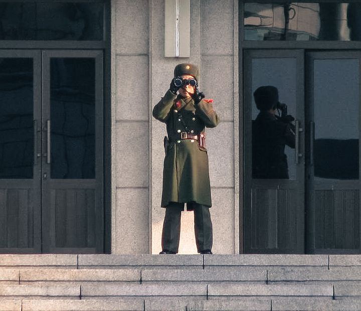 <em>This North Korean soldier has his eyes on a travel deal...probably a one-way ticket</em>