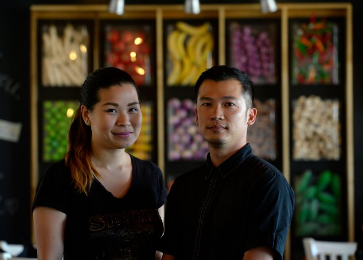 Nithiwadee Anantatho, left, and her husband, Surachai Surabotsopon, right, say a diner left a $1,000 tip at their restaurant