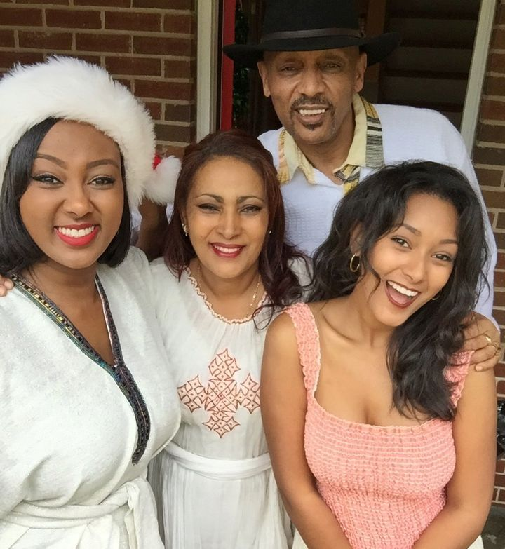 My mom, dad, sister and me decked out in our traditional Ethiopian clothing to celebrate Christmas.
