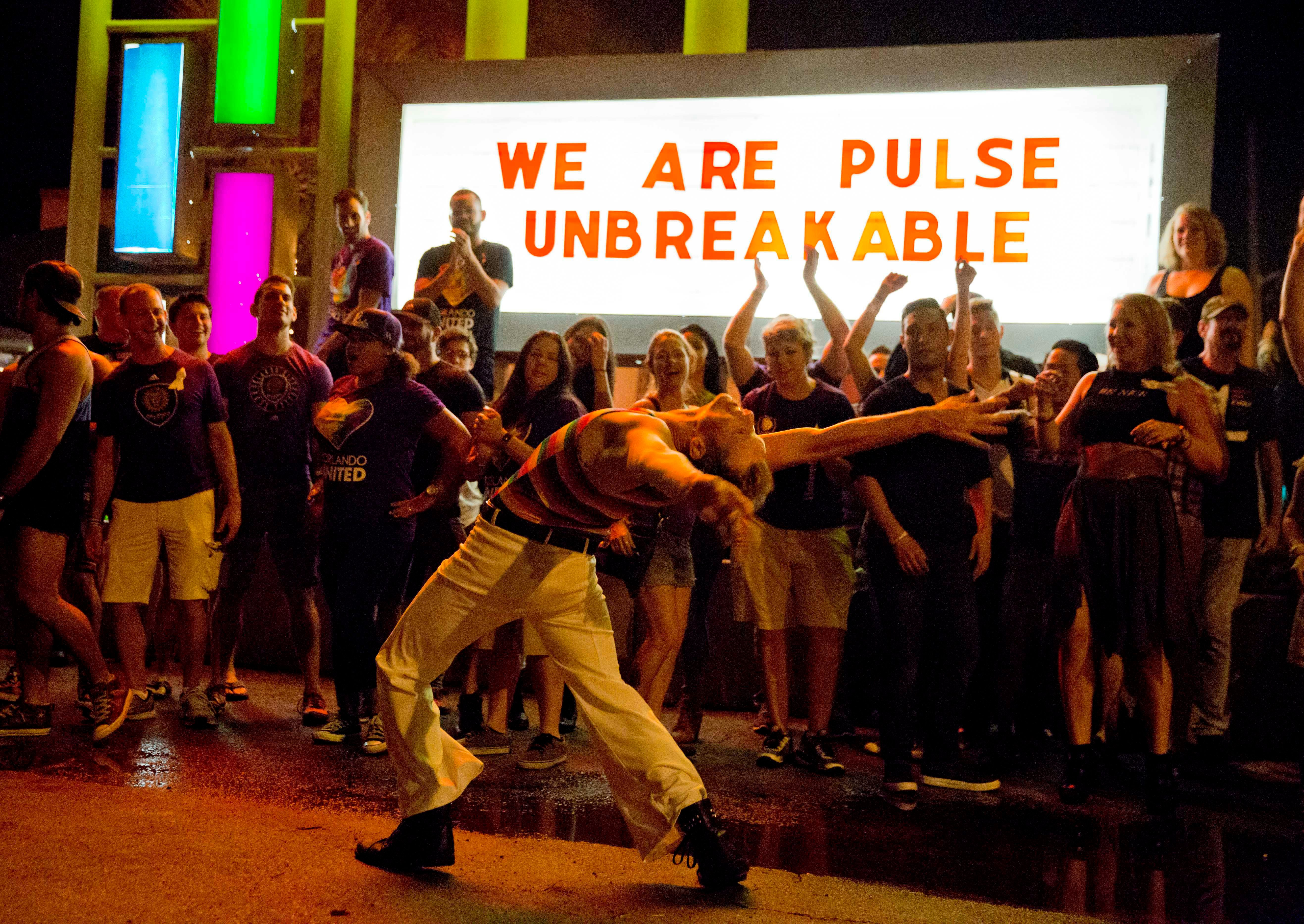 Steven Johnson dances among club goers as they gather outside Parliament House, an LGBT nightclub, late...
