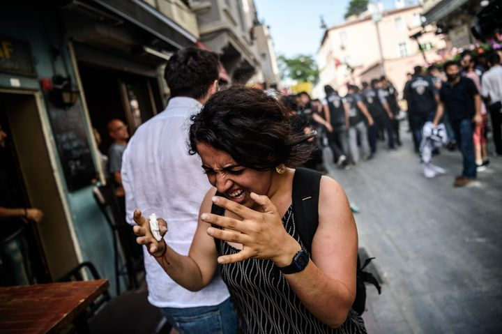A woman reacts after tear gas was fired at the LGBT rally in Istanbul.
