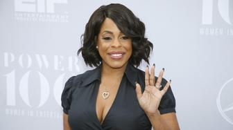Comedian Niecy Nash poses at The Hollywood Reporter's Annual Women in Entertainment Breakfast in Los Angeles, California December 9, 2015. REUTERS/Danny Moloshok