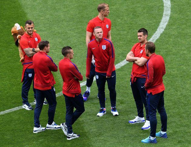 England Vs Slovakia:Wayne Rooney stands with team mates atSaint Etienne on