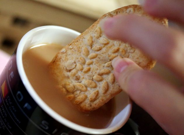 A Belvita breakfast biscuit with a cup of