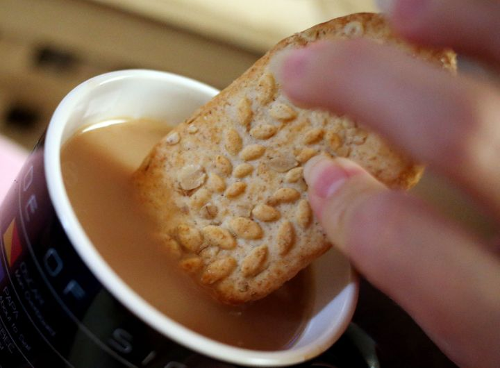 A Belvita breakfast biscuit with a cup of tea.