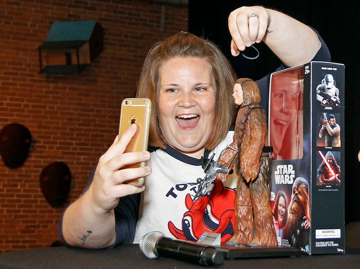 """Candace Payne, also known as """"Chewbacca Mom,"""" streams a Facebook Live video with her custom Chewbacca Mom action figure"""
