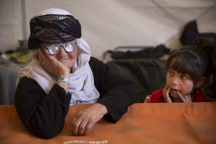 Shereen (left), an 85 year-old Yazidi grandmother, escaped the ISIS onslaught of Yazidi villages in Shengal, Iraq. Here, she