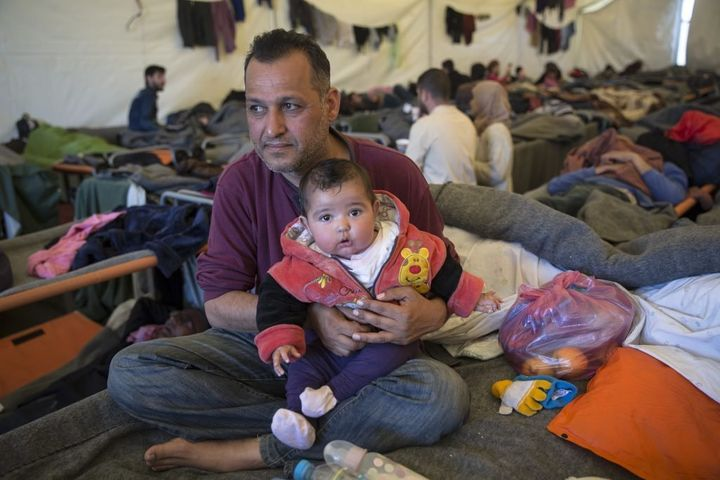 "Moayad Saad, a civil servant from Baghdad, Iraq, with his seven-month-old daughter Zehraa. ""€œWe are always together,"" he sai"