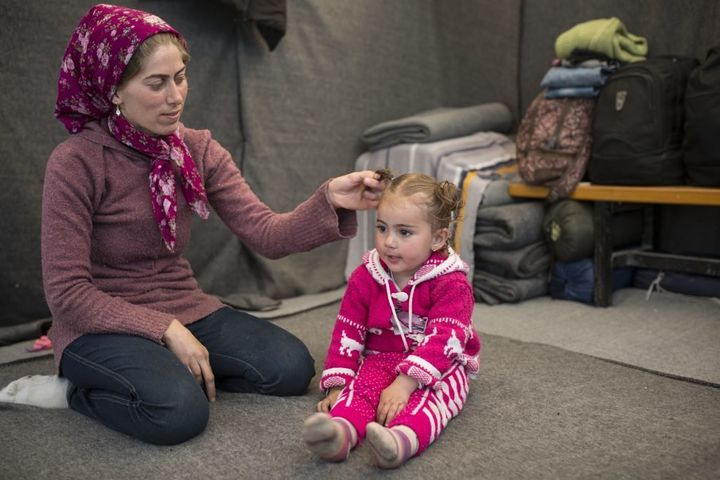 Makbola and her daughter Turqia play inside the tent where they stayed until a few weeks ago, when Idomeni camp was cleared o