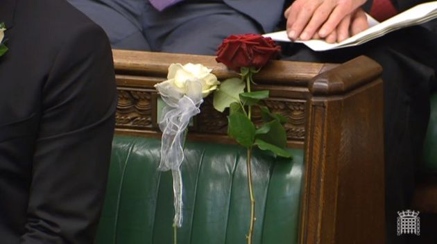 Cox was remembered in Parliament yesterday with a white and red rose placed on the bench where she used...