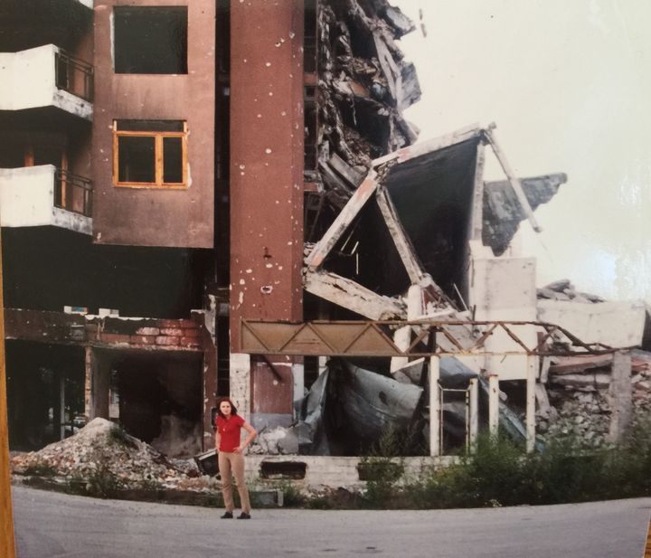 Author in front of a building, Sarajevo, 1996