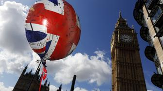 The design of a British Union Flag, also known as Union Jack, sits on a balloon filled with helium floating near the Houses of Parliament in London, U.K., on Wednesday, June 15, 2016. The campaigns for and against keeping the U.K. in the European Union laid out opposing visions of life outside the bloc as dueling ahead of next week's referendum enters its final stretch. Photographer: Luke MacGregor/Bloomberg via Getty Images