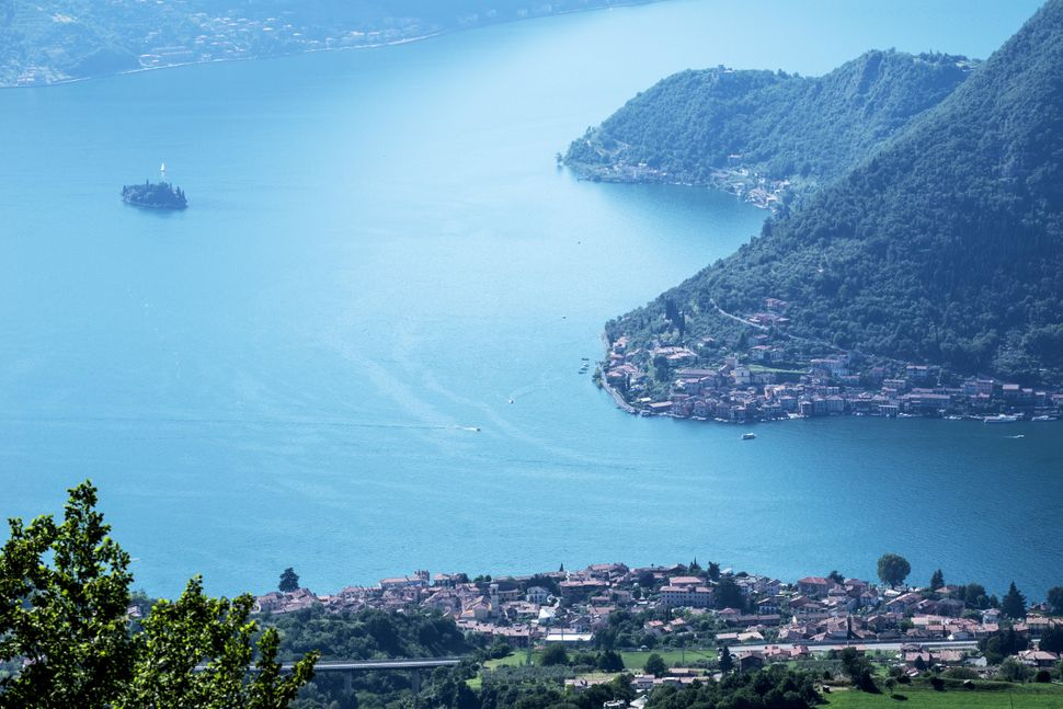 Lake Iseo with the town of Sulzano in the foreground, the island of Monte Isola on the right and the island of San Paolo on t