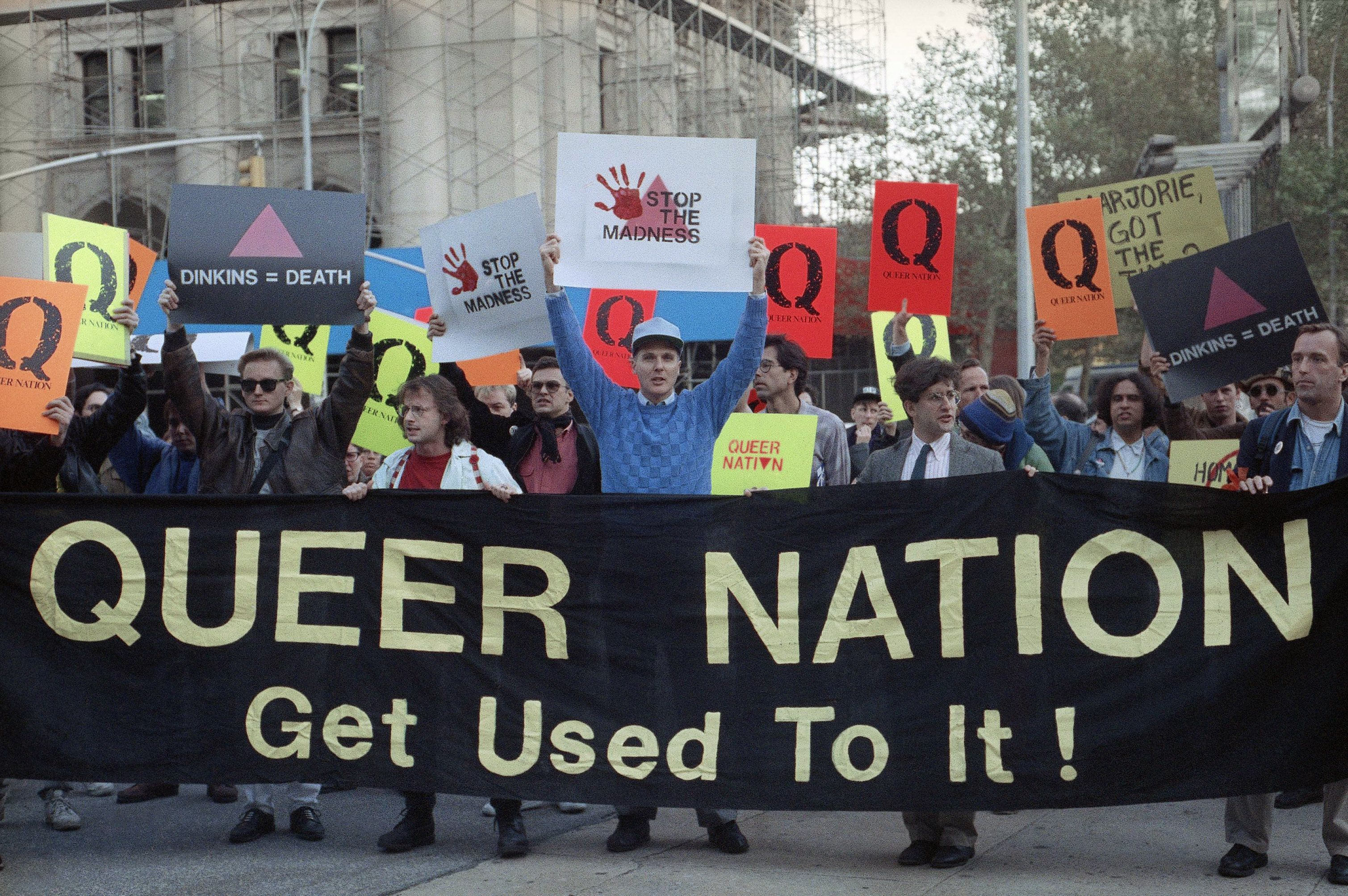 Members of the gay activist group, Queer Nation, rally outside New Yorks City Hall on Nov. 1, 1990 to protest what they say is Mayor Dinkins and the police departments inaction on violence against gays. Queer Nation is one of several militant day organizations which have discarded polite persuasion in favor of grab-them-by-the-lapels defiance. (AP Photo/Zoe Selsky)