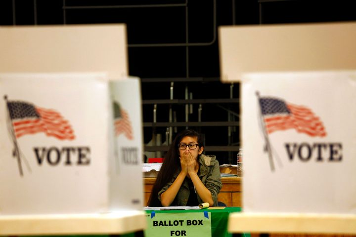 Election clerk Valerie Acosta waits for voters at the Kenter Canyon Elementary Charter School Auditorium.