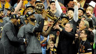 Jun 19, 2016; Oakland, CA, USA; Cleveland Cavaliers forward LeBron James (23) celebratew with the Larry O'Brien Championship Trophy after beating the Golden State Warriors in game seven of the NBA Finals at Oracle Arena. Mandatory Credit: Gary A. Vasquez-USA TODAY Sports     TPX IMAGES OF THE DAY