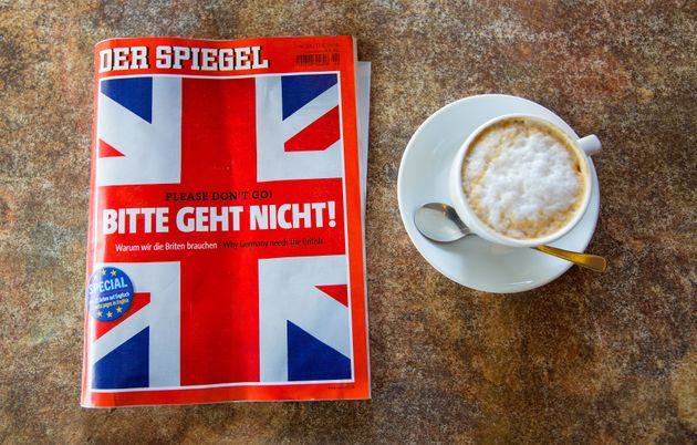 A copy of German magazine Der Spiegel featuring the headline 'Please don't go!' and a British Union flag...