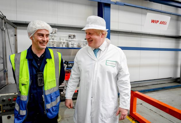 Former London Mayor Boris Johnson, right, visits a soap factory while campaigning for a Brexit.